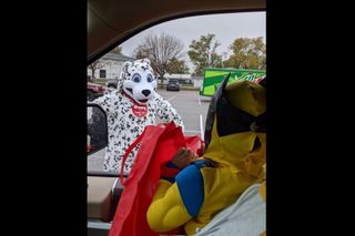 Local pizza chain mascot helps area kids have 'Happy' Halloween