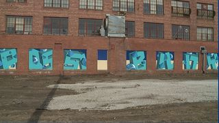 Spiegel building in downtown Moline uses art as a marketing tool